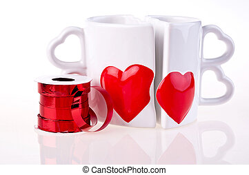Coffee mugs in shape of hear and ribbon