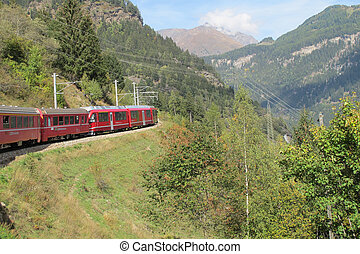 red train around the beautiful Swiss mountains 16 - famous...