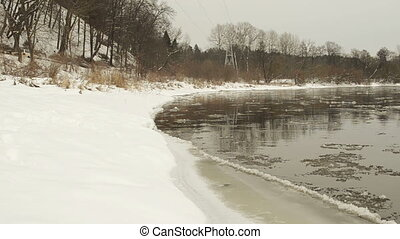 car river floe bank snow - car go on road and river...