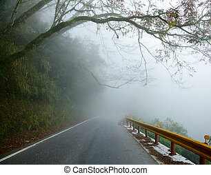 Misty road - Mountain road in Taiwan on a foggy day
