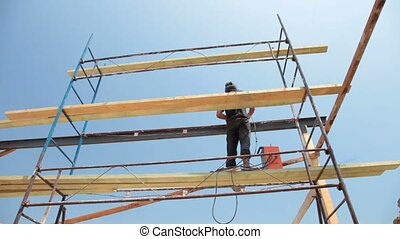 Roofing works -welder working on the scaffold