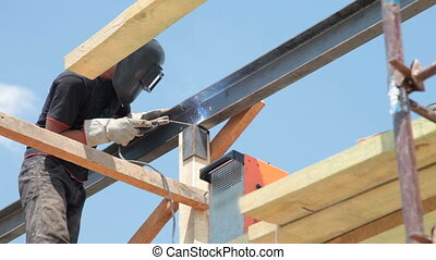 Roofing works - welder on scaffold - Roofing works - welder...
