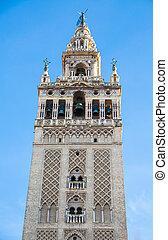 Giralda of Seville - The Giralda of Seville over blue sky,...