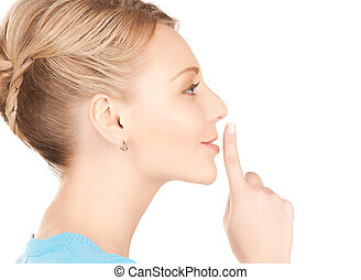 woman with finger on her lips - picture of mysterious woman...