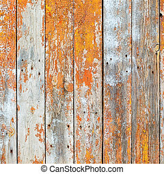 Old wooden planks painted with brown paint cracked by a...