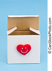 white gift box with red heart