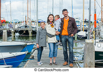 family vacation together in Yacht Club - Young happy family...