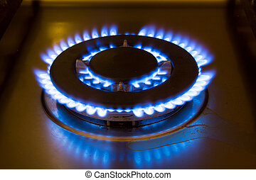 Gas burner from a stove with a blue flame