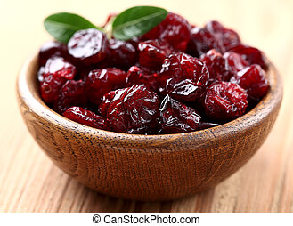 Dried cranberry on a wooden background