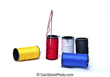 Rainbow of Spools - Yellow, red, blue, black, and white...