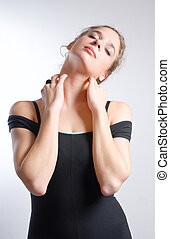 Young woman in leotard stretching neck