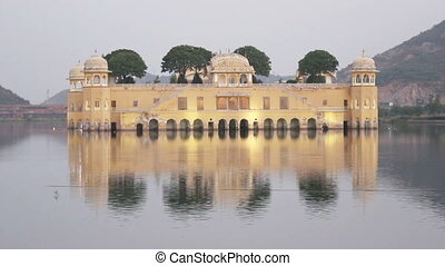jal mahal palace on lake in Jaipur India at evening - timelapse