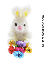Toy Bunny and Easter Eggs on White Background