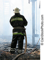 firefighters extinguish a fire in an apartment house -...