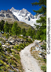 Hiking trail in Switzerland Alps, from Riffelalp to Grunsee,...