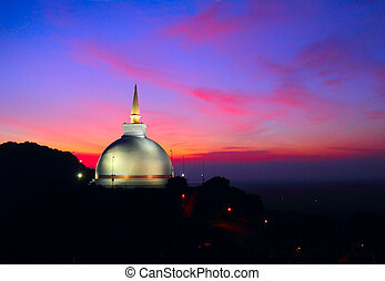 Scenic view of Mahaseya Stupa at sunset, Mihintale, Sri...