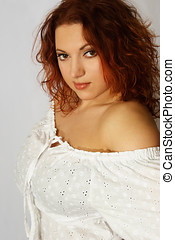 Beautiful red hair woman in white cloth