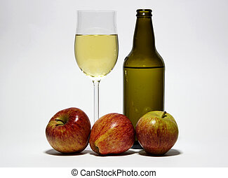 Cider - A bottle and glass of cider with some fresh apples....
