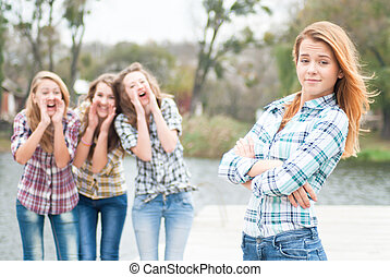 Three girls calling their friend