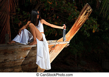 Woman on wooden boat holding a knife - Woman on long tailed...