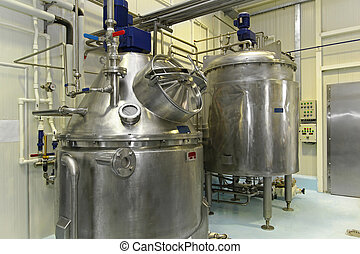 Tank for fermentation - Interior of dairy factory with...