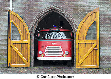 old fire truck in holland - old fire truck in dutch garage
