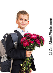 Schoolboy is holding flowers. Back to school - Handsome...
