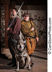 Swordfighters and Dog - Confident middle ages heroes with...