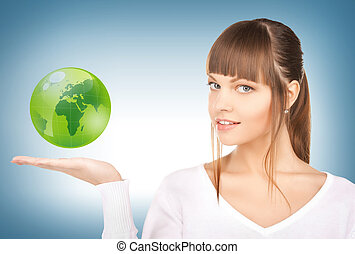 woman holding green globe on her hand - picture of woman...