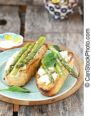 bruschetta with asparagus on the blue plate