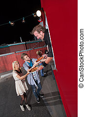 Teenagers Ordering Pizza from Food Truck - Happy teenagers...