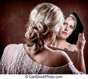 woman looking into a broken mirror - Woman looking into a...