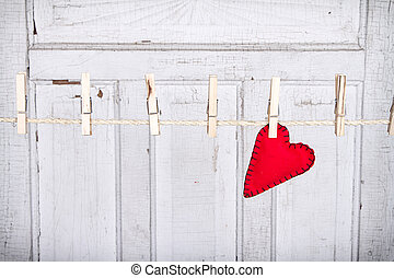 heart on a clothes line - Red heart on a clothes line with a...