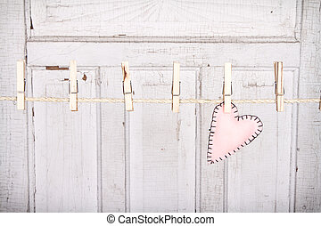 heart on a clothes line - Pink heart on a clothes line with...