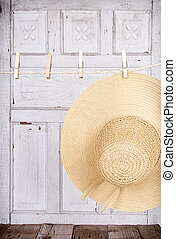 Sun hat hanging from a clothes line - Sun hat hanging froma...