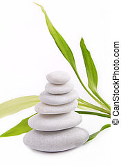 Zen stones isolated on white background with bamboo