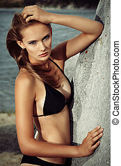 beach fashion - Romantic beautiful woman sunbathing on a...