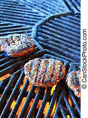 Cooking an hamburger - An hamburgher is cooking in a hot...