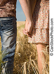 Loving couple holding hands on nature - Happy young couple...
