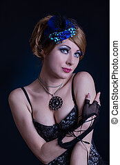 Retro-styled woman in cabaret outfit over dark back