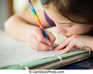 girl doing her homework - Cute little girl doing her...