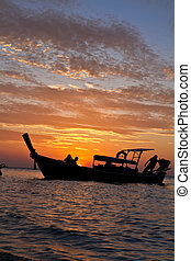 Longtail boat at sunset