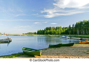 Nice lake landscape with vivid sky in summer