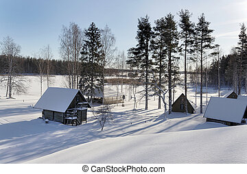 Landscape with houses in winter snow