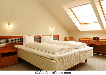 White bed in hotel room