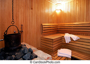 Sauna room with tovels and heating