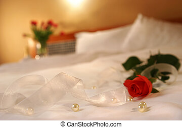 Romantic design with rose on bed