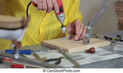 Making replica model of ship - Man making replica model of...