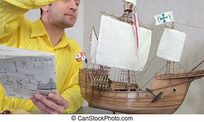 Hobby - model ship assembly kit - Man making replica model...