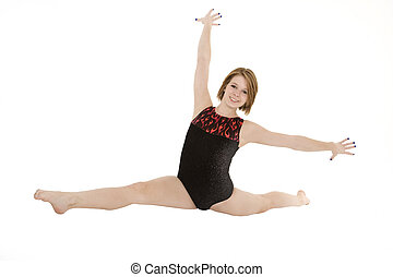Gymnastics - Caucasian teenage girl in gymnastic poses on...